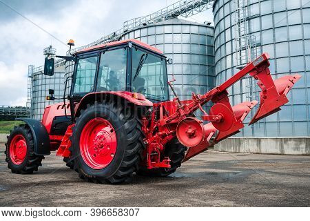Photo Of A New Tractor Ready To Work Early In The Morning. Farm Tractor With Plow On The Farm