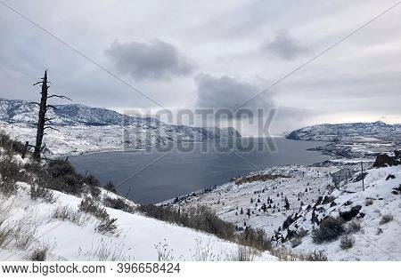 Frozen Mountain Kamloops Lake In Winter In Cloudy Weather. Winter Mountain Landscape. British Columb