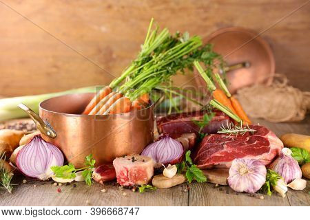 preparation of french traditional pot au feu or beef stew broth, soup and vegetables