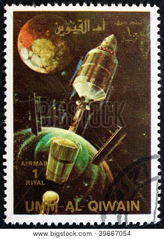 UMM AL-QUWAIN - CIRCA 1972: a stamp printed in the Umm al-Quwain shows A Rocket Jettisons Spent Stages, History of Spaceflight, circa 1972