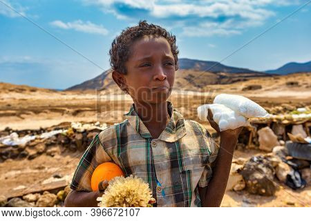 Djibouti,republic Of Djibouti - February 3,2013:a Boy Sells Crystals Of Salt On The Shore Of Lake As