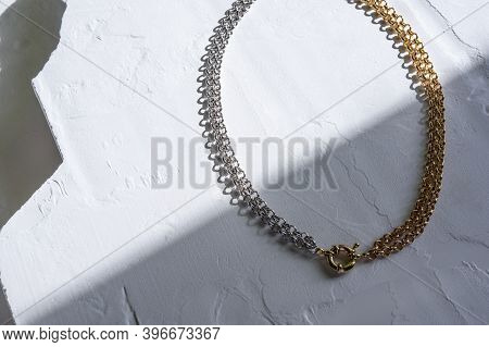 A Combination Of Chains Of Contrasting Color Coatings - Gold And Rhodium. With A Connecting Ring On