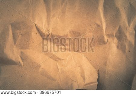 Background With Brown Crumpled Sheet Of Fabric With Vignette