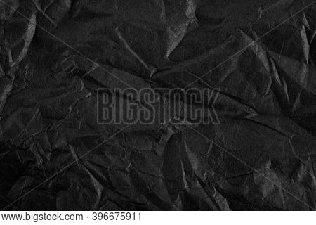 Background With Black Crumpled Sheet Of Paper With Vignetting
