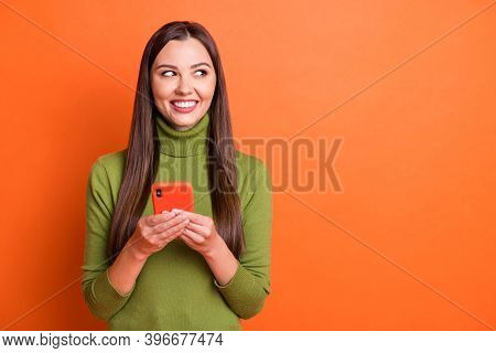Photo Of Young Beautiful Smiling Cheerful Positive Lovely Girl Look Copyspace Hold Smartphone Isolat