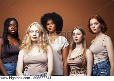Young Pretty Caucasian, Afro, Scandinavian Woman Posing Cheerful Together On Brown Background, Lifes