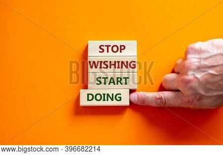 Time To Start Doing. Wooden Blocks Form The Words 'stop Wishing Start Doing' On Beautiful Orange Bac
