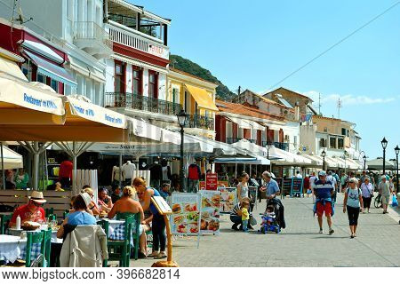 Paxos Harbour, Greece - October 01, 2017 : Tourist Visiting Paxos Harbour A Small Island South Of Co