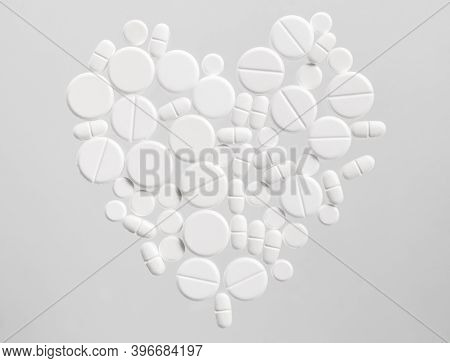 White Medical Pills In The Shape Of A Heart