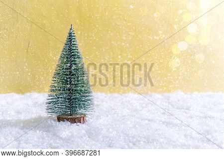 Christmas Toy Tree In Snowdrift. Beautiful Festive Background With Lights For Web, Print. Copy Space