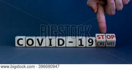 Stop Covid-19 Crimes. Hand Turns Cubes With Words 'stop Covid-19 Crimes'. Beautiful Grey Background.