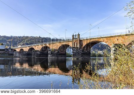 Old Roman Bridge In Trier Spanning The River Moselle