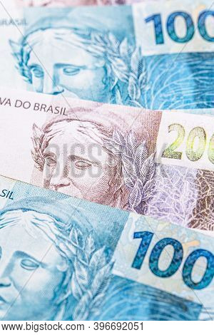 One Hundred And Two Hundred Reais Bills, Money From Brazil. Concept Of Brazilian Economy, Economic G