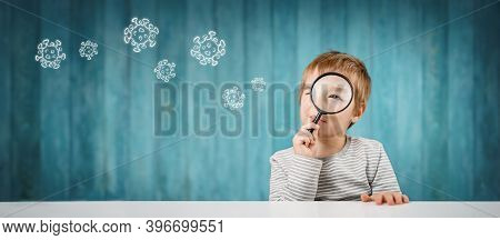 Little Boy Looking Through A Magnifying Glass