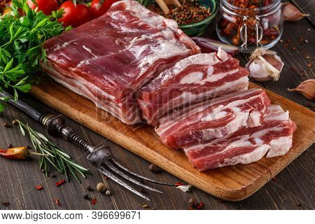 Fat Bacon On A Wooden Board. Close-up Fat Bacon With Garlic And Spices, Homemade Lard,slices Of Baco