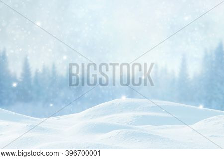 Winter Xmas  background with snowfall and blurred bokeh.Merry Christmas and happy New Year greeting card with copy-space. Christmas landscape with snow covered fir trees in forest