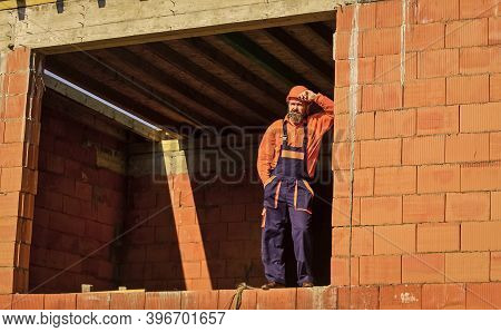 Daily Routine At Construction. Well Done. Repairman Tired Builder Relaxing At Construction Site. Bui
