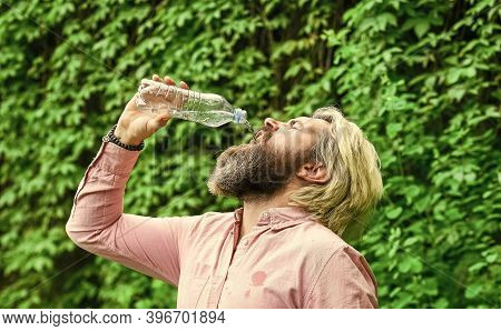 Drain The Bottle. Daily Intake Of Water. Thirsty Male Model Enjoying Refreshing Drink. Healthy Eatin