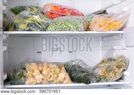 Plastic Bags With Deep Frozen Vegetables In Refrigerator, Horizontal