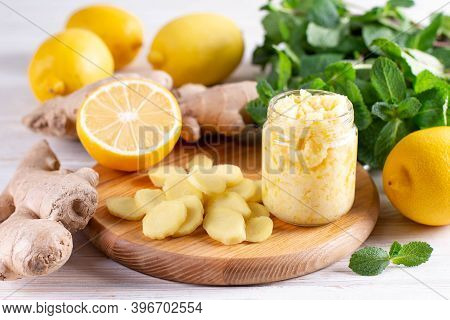 Homemade Ginger And Lemon Jam On Wooden Background. Natural Products To Support The Immune System In