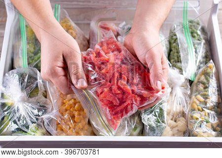 Frozen Red Peppers. Frozen Vegetables In A Plastic Bag In Freezer