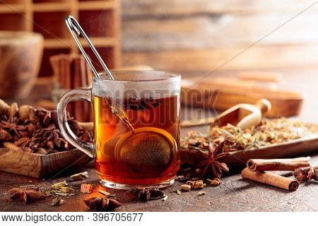 Christmas Herbal Tea With Cinnamon, Anise, And Dried Herbs. Herbal Tea With Spices In Wooden Dishes