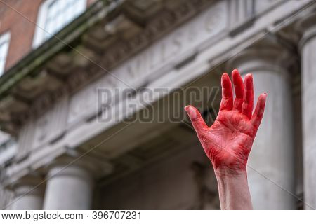 London, Uk - October 18, 2019: A Hand Painted Red In Front Of A Building At An Extinction Rebellion