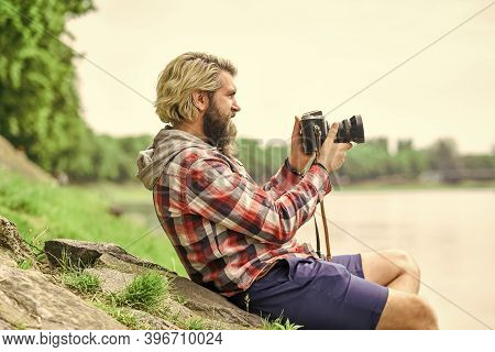Content Creator. Man Bearded Hipster Photographer Hold Vintage Camera. Masterpiece Shot. Man With Be
