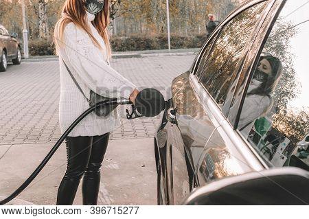 Pumping Gas Fuel Car At Oil Station. Woman Hand Refuel Petrol Nozzle Tank. Refueling Transportation
