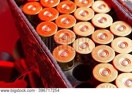 Shotgun Cartridges In A Cartridge Bag In Red Light Close Up
