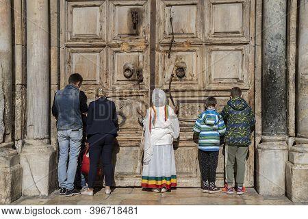 Jerusalem, Israel - November 21st, 2020: Worshipers Praying At The Closed Doors (due To Corona Virus