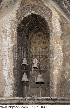 Jerusalem, Israel - November 21st, 2020: Old Church Bells In A Niche On The Roof Of The Church Of Th