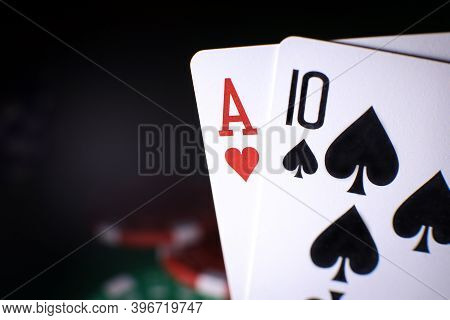 Poker Playing Chips With Cards Close Up Against The Back Background. . Online Gambling. Addiction. F