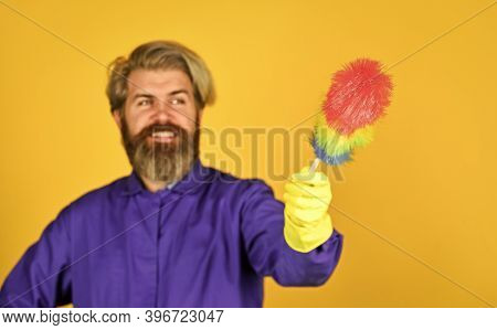 Male Sweeping With Small Duster Broom. Cleaning Service. Housekeeping Business. Cleaning The Apartme