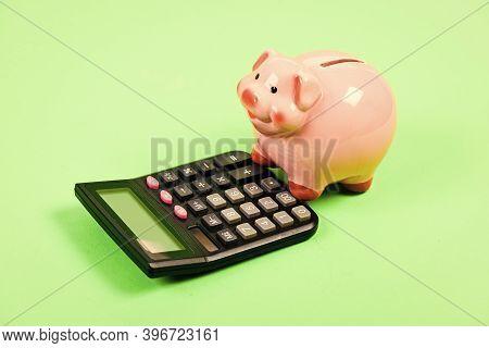 Investing Gain Profit. Piggy Bank Pig And Calculator. Credit Debt Concept. Economics And Profit Mana