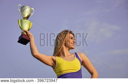 Sport Success. Gold Prize. Cute Athlete Being Awarded With Cup. First Place Award And Success. Girl