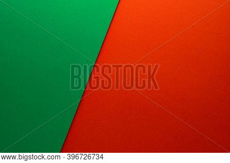Beautiful Background Of Two Unequal Parts Of Green And Red Paper. Sheets Of Blank Green And Red Pape