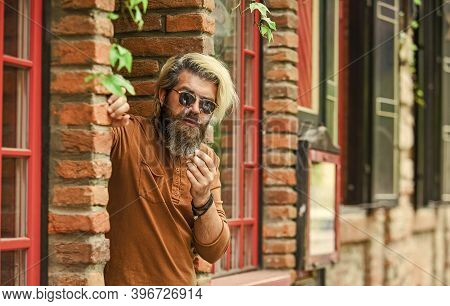 Cool Guy Relaxing. Hipster Smoking Old Architecture Background. Smoking Outdoors. Went On Smoke Brea