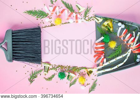 Christmas Cleaning After The Mess. Cleaning Tools Broom And Scoop And Unused Christmas Decorations A