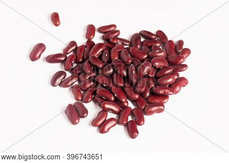 Raw Mexican Red Kidney Beans On White Background, Food Ingredient Studio Shot.