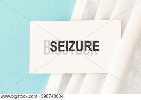 Word Seizure With Medical Mask On A Blue Background. Preventive Medicine