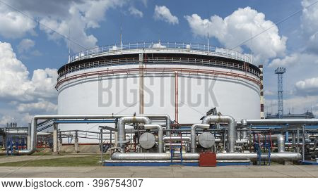 Oil Depot Storage Tanks. Large White Industrial Tanks For Petrol And Oil On Classic Blue Sky Backgro