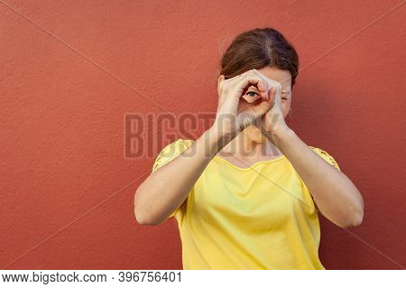 Girl Feeling Lucky Showing Okay Circle Over Eye, Grinning Happily Standing On Colored Background. Pr