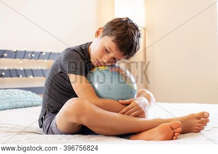 Young Boy Holding World In The Palm Of His Hands Concept For Education, Travel, Communications, Poli
