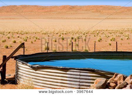 Corrugated Iron Dam On Desert Farm