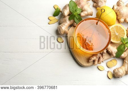 Ginger, Honey And Lemon On White Wooden Table, Flat Lay With Space For Text. Natural Cold Remedies