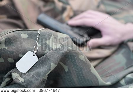 Dog Tags Lies With Hand Of Depressive Man Who Commit Suicide With A Gun