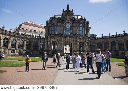 Dresden, Germany - June 05, 2013: Group Of Tourists In The Architectural And Park Ensemble Of Zwinge