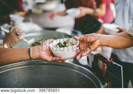 Hungry People Brought Utensils To Obtain Food From Volunteers: The Concept Of Begging And Hunger