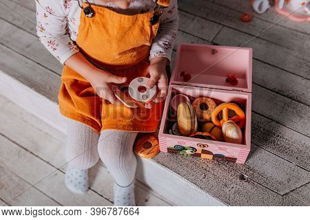 Toy Kitchen Presents For Girls. Christmas Present Under The Tree. Little Girl Playing Toy Wooden Kit
